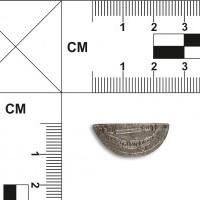 Połówka srebrnej monety arabskiej (dirhem)